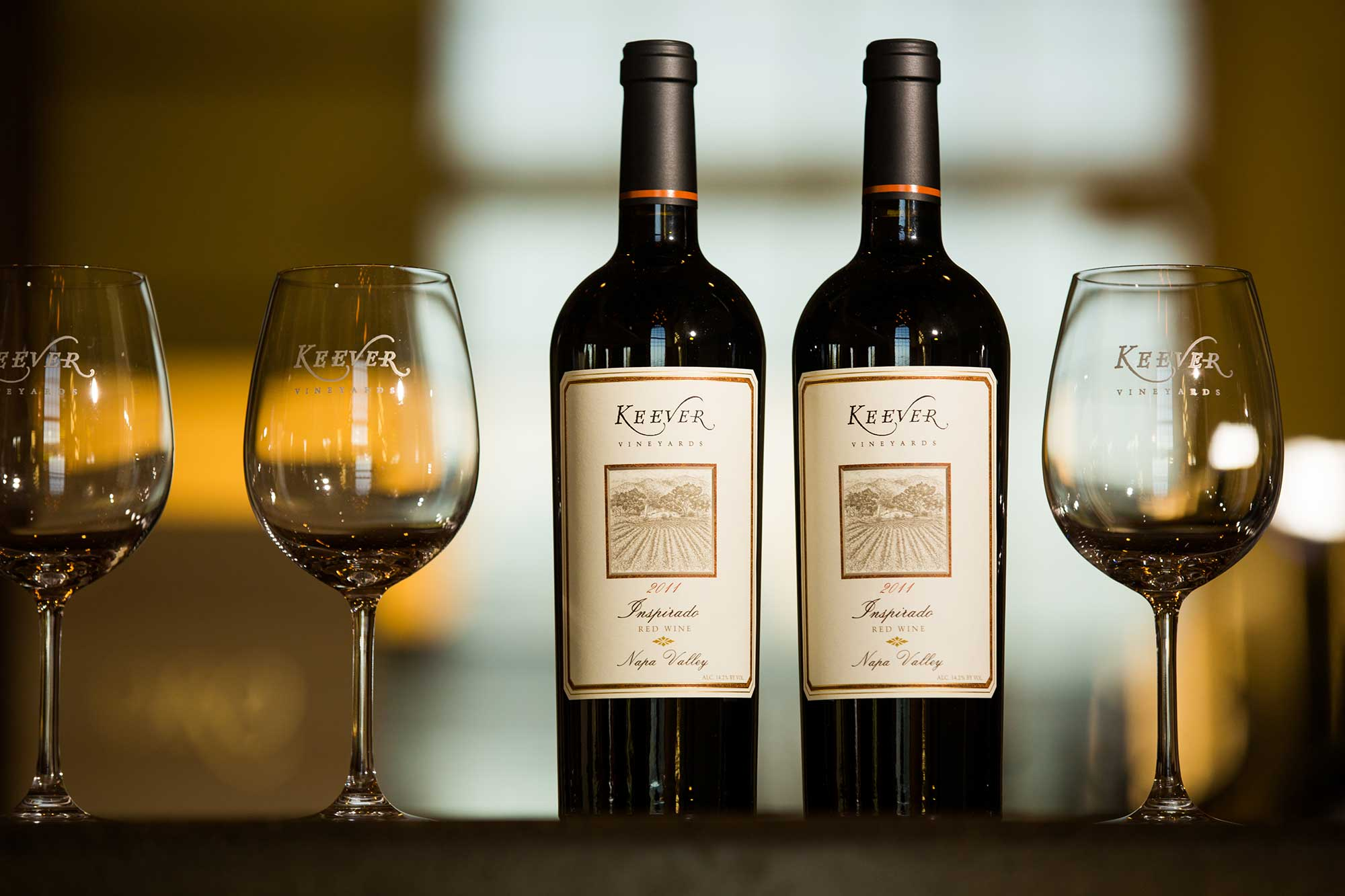 Keever Vineyards bottles and glasses in the winery tasting room in Yountville, California