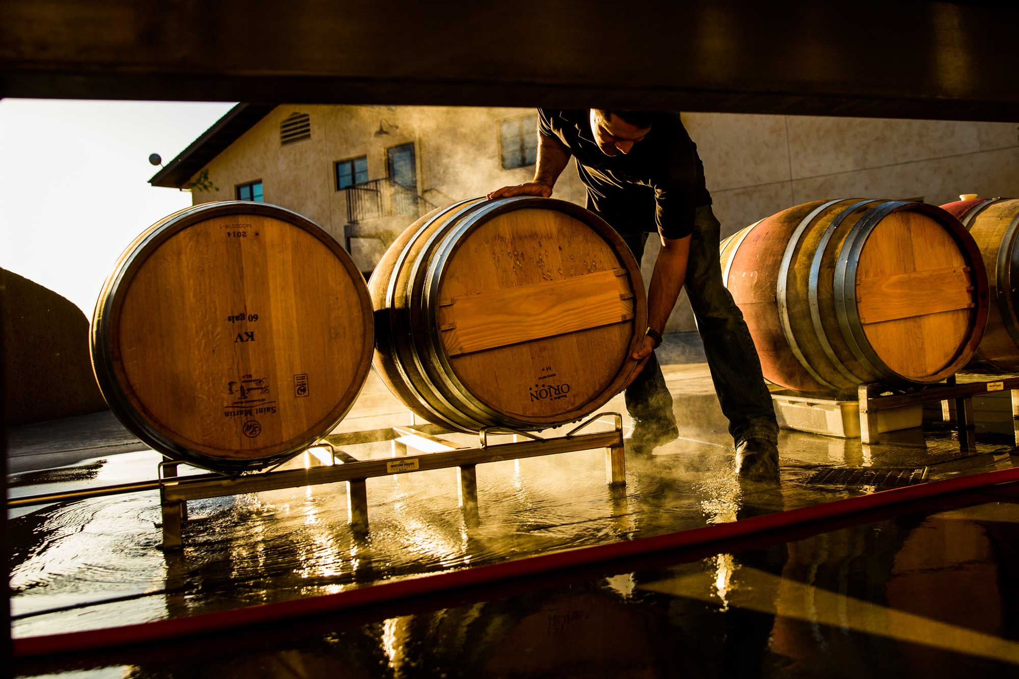 Handling barrels at the winery at Keever Vineyards in Yountville, California